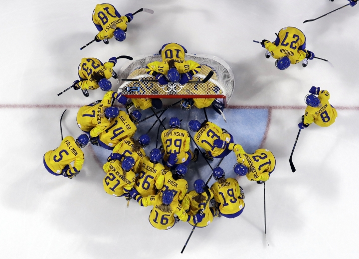 "FILE - In this Feb. 2, 2018, file photo, players from Sweden gather before the preliminary round of the women's hockey game against the combined Koreas at the 2018 Winter Olympics in Gangneung, South Korea. The leading female hockey players in Sweden were refusing to attend a training camp Thursday or play in an upcoming international tournament in Finland over a pay dispute with the country's federation. The Swedish Ice Hockey Federation said it has been informed of the boycott and is ""surprised"" at the decision.(AP Photo/Kiichiro Sato, File)"