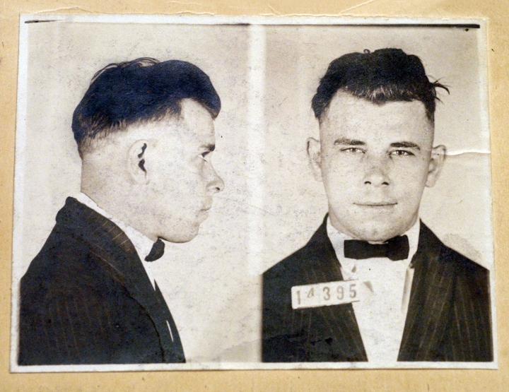 "FILE - This file photo shows Indiana Reformatory booking shots of John Dillinger, stored in the state archives. Two relatives of notorious 1930s gangster, who plan to have his remains exhumed as part of a television documentary say they have ""evidence"" the body buried in an Indianapolis cemetery may not be him and that FBI agents possibly killed someone else in 1934. (Charlie Nye/The Indianapolis Star via AP)"