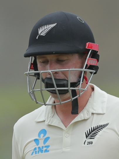 New Zealand's Henry Nicholls leaves the field after being dismissed during the third day of the first test cricket match between Sri Lanka and New Zealand in Galle, Sri Lanka, Friday, Aug. 16, 2019. (AP Photo/Eranga Jayawardena)