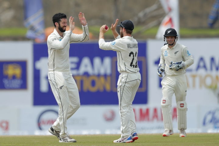 New Zealand's William Somerville, left, celebrates taking the wicket of Sri Lanka's Niroshan Dickwella with captain Kane Williamson during the third day of the first test cricket match between Sri Lanka and New Zealand in Galle, Sri Lanka, Friday, Aug. 16, 2019. (AP Photo/Eranga Jayawardena)