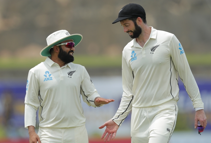 New Zealand's William Somerville, right, and Ajaz Patel cheer each others during the third day of the first test cricket match between Sri Lanka and New Zealand in Galle, Sri Lanka, Friday, Aug. 16, 2019. (AP Photo/Eranga Jayawardena)