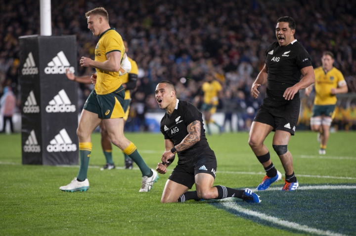 All Blacks halfback Aaron Smith, center, celebrates after scoring against Australia during a Bledisloe Cup rugby test between the All Blacks and Australia at Eden Park in Auckland, New Zealand, Saturday, Aug. 17, 2019. (Brett Phibbs/SNPA via AP)