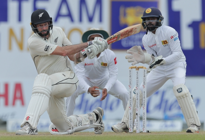 New Zealand's William Somerville plays a shot as Sri Lanka's wicketkeeper Niroshan Dickwella watches during the fourth day of the first test cricket match between Sri Lanka and New Zealand in Galle, Sri Lanka, Saturday, Aug. 17, 2019. (AP Photo/Eranga Jayawardena)