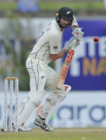 New Zealand's William Somerville plays a shot during the fourth day of the first test cricket match between Sri Lanka and New Zealand in Galle, Sri Lanka, Saturday, Aug. 17, 2019. (AP Photo/Eranga Jayawardena)