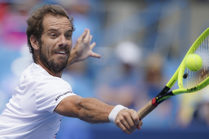 Richard Gasquet, of France, returns to David Goffin, of Belgium, during the Western & Southern Open tennis tournament, Saturday, Aug. 17, 2019, in Mason, Ohio. (AP Photo/John Minchillo)