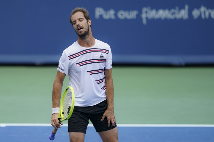Richard Gasquet, of France, reacts during a match against David Goffin, of Belgium, during the Western & Southern Open tennis tournament, Saturday, Aug. 17, 2019, in Mason, Ohio. (AP Photo/John Minchillo)