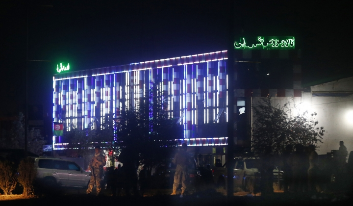 Afghan police men stand guard outside the wedding hall after an explosion in Kabul, Afghanistan, Sunday, Aug.18, 2019. An explosion ripped through the wedding hall on a busy Saturday night in Afghanistan's capital and dozens of people were killed or wounded, a government official said. Hundreds of people were believed to be inside. (AP Photo/Rafiq Maqbool)
