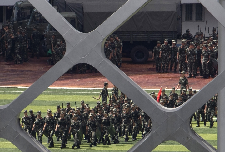 Chinese paramilitary policemen go through drills at the Shenzhen Bay Stadium in Shenzhen in Southern China's Guangdong province on Sunday, Aug. 18, 2019. A spokesman for China's ceremonial legislature has condemned statements from U.S. lawmakers supportive of Hong Kong's pro-democracy movement. (AP Photo/Ng Han Guan)
