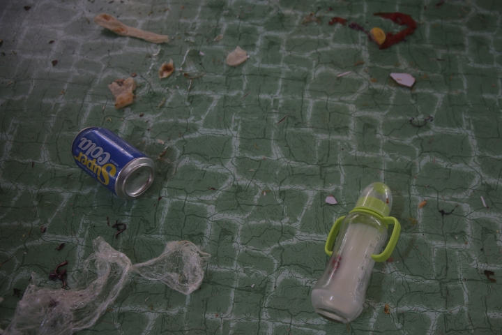 An empty soda can and a milk bottle lie among other debris at a damaged Dubai City wedding hall after an explosion in Kabul, Afghanistan, Sunday, Aug. 18, 2019. A suicide-bomb blast ripped through a wedding party on a busy Saturday night. (AP Photo/Rafiq Maqbool)
