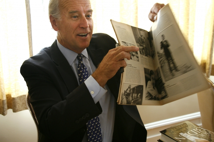 "FILE - In this Aug. 13, 2008, file photo, then-Democratic presidential hopeful Sen. Joe Biden holds up a 1972 ""Life"" magazine with his picture in it that was given to him to sign after speaking to the Nashua Rotary Club in Nashua, N.H. (AP Photo/Cheryl Senter, File)"