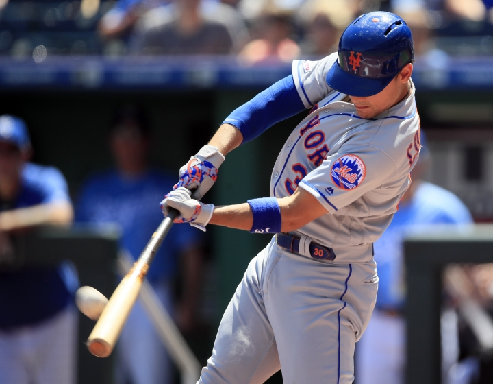 New York Mets' Michael Conforto hits a three-run home run off Kansas City Royals starting pitcher Glenn Sparkman during the first inning of a baseball game at Kauffman Stadium in Kansas City, Mo., Sunday, Aug. 18, 2019. (AP Photo/Orlin Wagner)