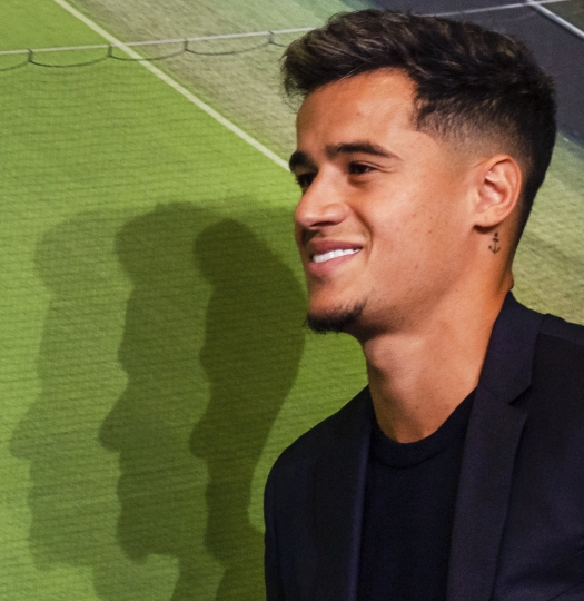 New player for Bayern Munich Philippe Coutinho goes to a press conference in the stadium in Munich, Germany, Monday, Aug.19, 2019. Coutinho comes as a loaner for one year from FC Barcelona. (Peter Kneffel/dpa via AP)