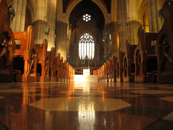 FILE - In this Sept. 9, 2018, file photo, pews line the shiny isle inside the St. Patrick's Cathedral in Melbourne. Cardinal George Pell's appeal against his convictions for child molestation was largely a question of who the jury should have believed, his accuser or a senior priest whose church role was likened to Pell's bodyguard. Pell's accuser was a 13-year-old choirboy when he alleged that he was abused by then-Melbourne Archbishop Pell at the city's St. Patrick's Cathedral in December 1996 and February 1997. (AP Photo/Rod McGuirk, File)