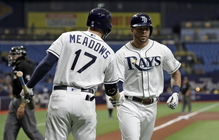 Tampa Bay Rays' Tommy Pham, right, celebrates with on-deck batter Austin Meadows after Pham hit a home run off Seattle Mariners starting pitcher Marco Gonzales during the first inning of a baseball game, Monday, Aug. 19, 2019, in St. Petersburg, Fla. (AP Photo/Chris O'Meara)