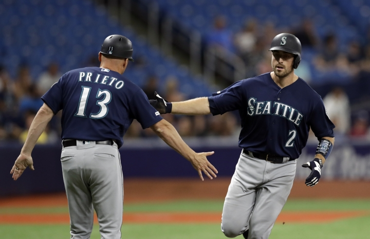 Seattle Mariners' Tom Murphy (2) shakes hands with third base coach Chris Prieto (13) after Murphy hit a three-run home run off Tampa Bay Rays starting pitcher Brendan McKay during the first inning of a baseball game Monday, Aug. 19, 2019, in St. Petersburg, Fla. (AP Photo/Chris O'Meara)