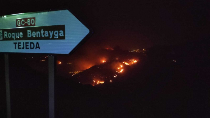 In this photo issued by Cabildo de Gran Canaria, flames from a forest fire burn in Tejada, on the Spanish Gran Canaria island on Tuesday Aug. 20, 2019. The wind dropped overnight in the Canary Islands, allowing firefighters to make progress Tuesday against Spain's biggest wildfire so far this year. More than 12,000 hectares (30,000 acres) have been charred on the western slopes of Gran Canaria, an island off northwest Africa. (Cabildo de Gran Canaria Via AP)