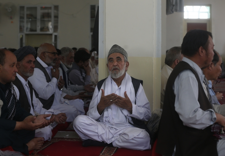 Afghan pray for the victims of the Dubai City wedding hall bombing during a memorial service at a mosque in Kabul, Afghanistan, Tuesday, Aug. 20, 2019. Hundreds of people have gathered in mosques in Afghanistan's capital for memorials for scores of people killed in a horrific suicide bombing at a Kabul wedding over the weekend. (AP Photo/Rafiq Maqbool)
