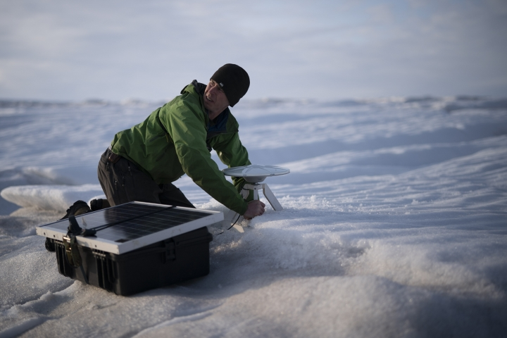 """In this Aug. 16, 2019, photo, Brian Rougeux, NYU Field Safety Officer, installs a GPS antenna at the Helheim glacier, in Greenland. An NYU team is tracking what's happening in Greenland from both above and below. The head of the New York University team, air and ocean scientist David Holland, calls Greenland """"the end of the planet"""" referring to geography more than the future. Yet in many ways Greenland is where the planet's warmer and watery future is being written. (AP Photo/Felipe Dana)"""