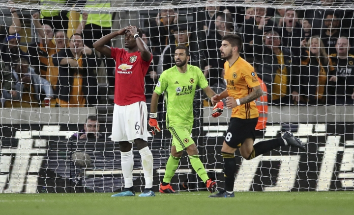 Manchester United's Paul Pogba reacts after his penalty was saved by Wolverhampton Wanderers goalkeeper Rui Patricio during the English Premier League soccer match between Wolverhampton Wanderers and Manchester United at the Molineux Stadium in Wolverhampton, England, Monday, Aug. 19, 2019. (Nick Potts/PA via AP)