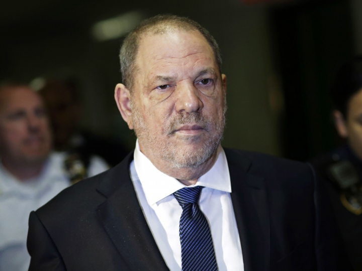 FILE - In this Oct. 11, 2018, file photo, Harvey Weinstein enters State Supreme Court in New York. A lawyer for Weinstein has asked that the disgraced movie mogul's upcoming criminal trial be moved out of New York City, saying he can't get a fair trial. In a longshot motion filed with the state appellate court on Friday, Aug. 16, 2019, attorney Arthur Aidala suggested the trial be moved to upstate Albany County or Suffolk County on Long Island. (AP Photo/Mark Lennihan, File)