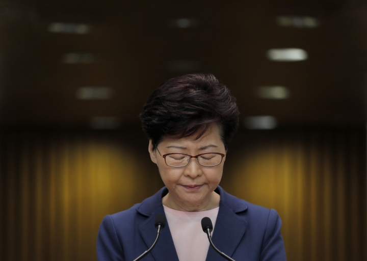 FILE - In this July 9, 2019, file photo, Hong Kong Chief Executive Carrie Lam pauses during a press conference in Hong Kong. Hong Kong's protest movement has reached a moment of reckoning after protesters occupying the airport held two mainland Chinese men captive, and pro-democracy lawmakers and fellow demonstrators question whether the whole operation has gone too far. (AP Photo/Vincent Yu, File)