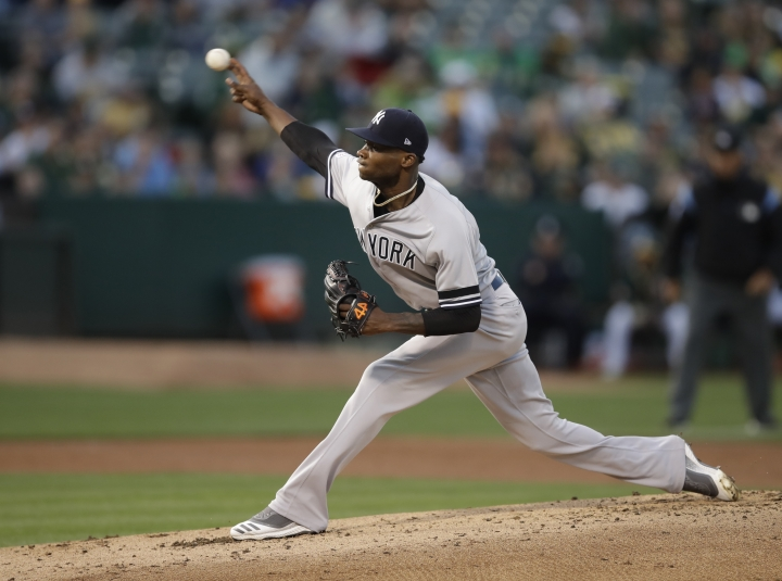 New York Yankees pitcher Domingo German works against the Oakland Athletics during the first inning of a baseball game Tuesday, Aug. 20, 2019, in Oakland, Calif. (AP Photo/Ben Margot)
