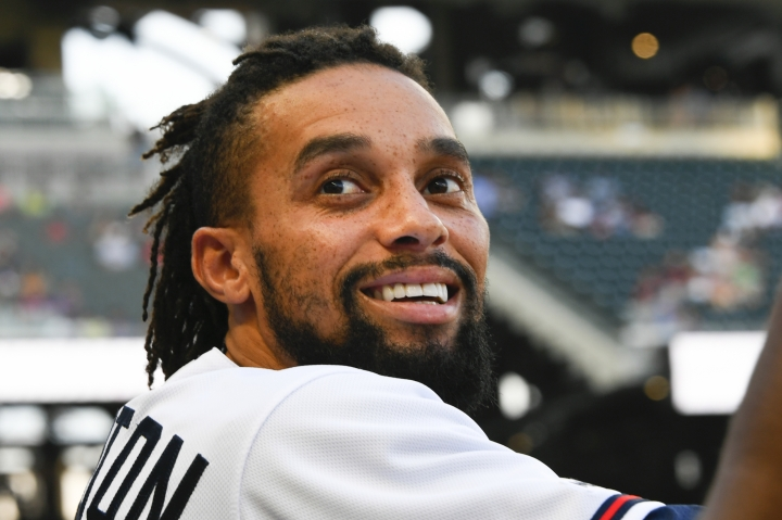 Atlanta Braves outfielder Billy Hamilton stands in the dugout during the second inning of a baseball game against the Miami Marlins, Tuesday, Aug. 20, 2019, in Atlanta. Hamilton was recently acquired from the Kansas City Royals. (AP Photo/John Amis)