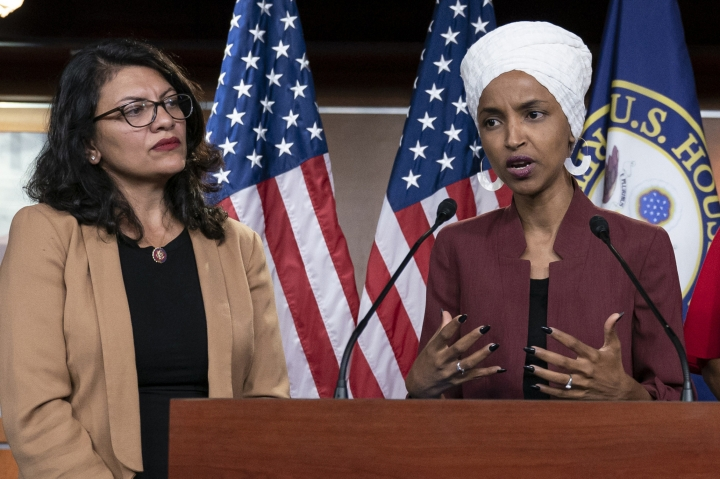 FILE - In this July 15, 2019, file photo, U.S. Rep. Ilhan Omar, D-Minn, right, speaks, as U.S. Rep. Rashida Tlaib, D-Mich. listens, during a news conference at the Capitol in Washington. Reps. Omar and Tlaib plan to host a news conference Monday, Aug. 19, 2019 on travel restrictions to Israel and Palestine, after they were denied entry into Israel last week. (AP Photo/J. Scott Applewhite, File)