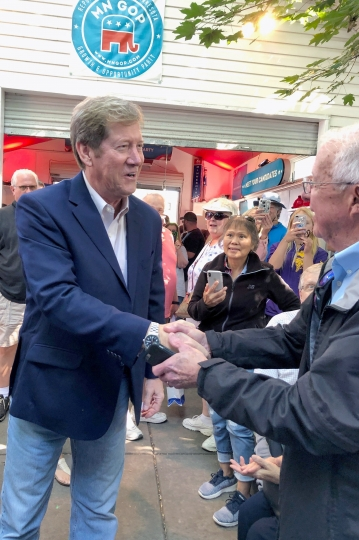 Republican U.S. Senate candidate and former congressman Jason Lewis, left, shakes hands with voters at the Minnesota State Fair, Thursday, Aug. 22, 2019, in Falcon Heights, Minn., where he announced that he's running for the GOP nomination to challenge Democratic incumbent U.S. Sen. Tina Smith. (AP Photo/Steve Karnowski)