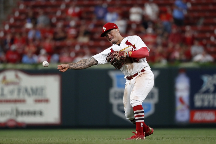 St. Louis Cardinals second baseman Kolten Wong throws out Colorado Rockies' Daniel Murphy at first during the eighth inning of a baseball game Thursday, Aug. 22, 2019, in St. Louis. (AP Photo/Jeff Roberson)