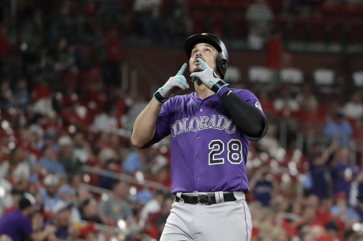 Colorado Rockies' Nolan Arenado looks skyward as he arrives at home after hitting a three-run home run during the fifth inning of the team's baseball game against the St. Louis Cardinals on Thursday, Aug. 22, 2019, in St. Louis. (AP Photo/Jeff Roberson)