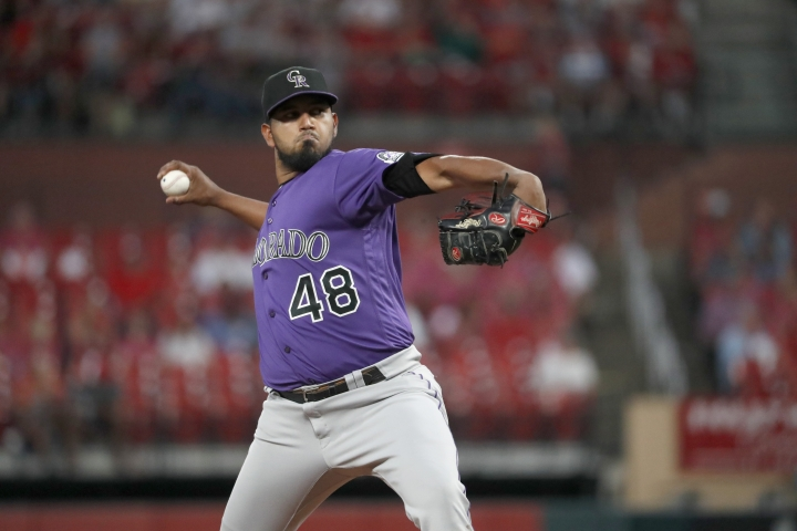 Colorado Rockies starting pitcher German Marquez throws during the first inning of the team's baseball game against the St. Louis Cardinals on Thursday, Aug. 22, 2019, in St. Louis. (AP Photo/Jeff Roberson)