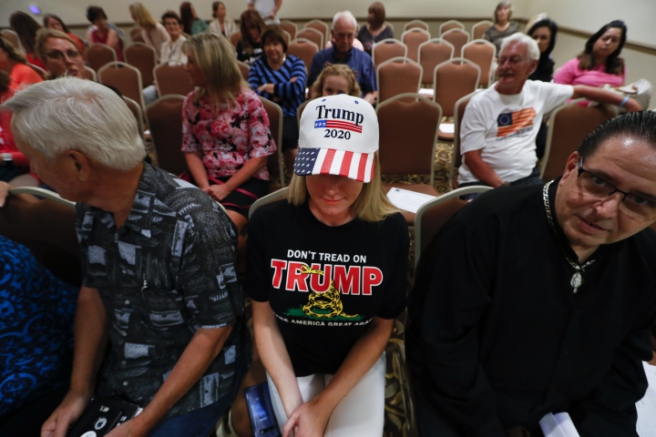 Lisa Mankiewicz sits in the audience during a training session for Women for Trump, An Evening to Empower, in Troy, Mich., Thursday, Aug. 22, 2019. President Donald Trump's campaign is rallying and training a corps of female defenders, mindful that Trump's shaky standing with women could sink his hopes of reelection next year. Female surrogates and supporters fanned out across important battlegrounds Thursday in a high-profile push to make the president's case on the economy and to train campaign volunteers. (AP Photo/Paul Sancya)