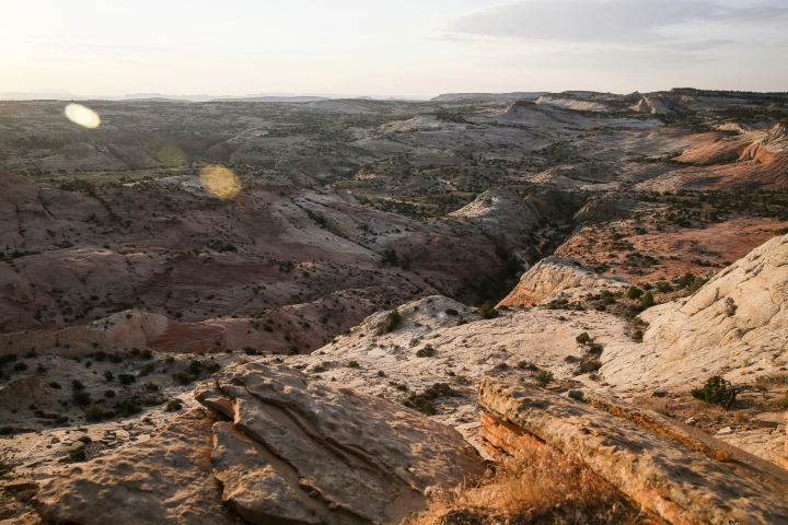 FILE - This July 9, 2017 file photo, shows a view of Grand Staircase-Escalante National Monument in Utah. The U.S. government's final management plan for lands in and around the Utah national monument that President Donald Trump downsized is light on new protections for the cliffs, canyons, waterfalls and arches found there, but it does include a few more safeguards than were in a proposal last year. A summary the Bureau of Land Management provided to The Associated Press shows that the plan for the Grand Staircase-Escalante National Monument in southwestern Utah codifies that the lands cut out of the monument will be open to mineral extraction such as oil, gas and coal as expected. (Spenser Heaps/The Deseret News via AP, File)