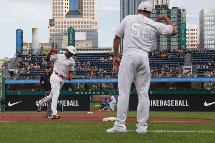 Cincinnati Reds' Aristides Aquino, left, celebrates with third base coach J.R. House as he rounds third after hitting a solo home run during the second inning of a baseball game, Friday, Aug. 23, 2019, in Pittsburgh. (AP Photo/Keith Srakocic)
