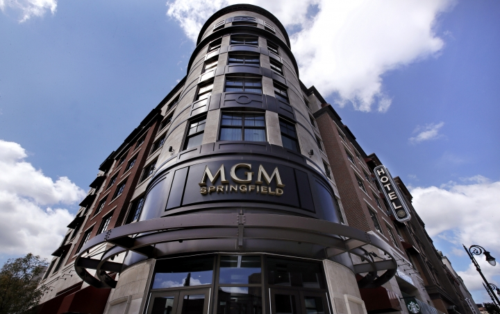 FILE -- In this Aug. 15, 2018 file photo the MGM Springfield casino's logo decorates the front facade on Main Street in Springfield, Mass. Massachusetts' first Las Vegas-style casino is throwing itself a birthday bash, Saturday, Aug. 24, 2019, with Aerosmith, New England Patriots cheerleaders and a five-tier cake. But one year after opening, MGM Springfield has underperformed and shed hundreds of jobs. Some business owners also say the promised downtown revival hasn't materialized. (AP Photo/Charles Krupa, File)