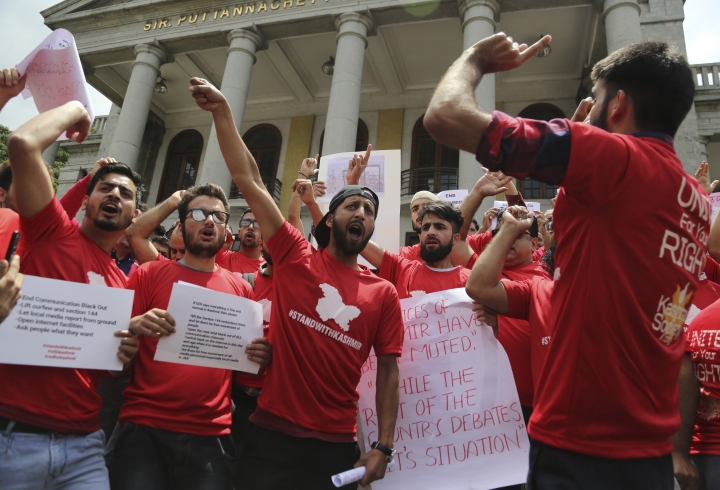 Kashmiris living in Bangalore shout slogans against the communication blockade in Indian controlled Kashmir during a protest in Bangalore, India, Saturday, Aug. 24, 2019. On Aug. 5, Prime Minister Narendra Modi's Hindu nationalist-led government revoked Muslim-majority Kashmir's decades-old special status guaranteed under Article 370 of India's Constitution and sent thousands of troops to the region, which is split between archrivals Pakistan and India and claimed by both in its entirety. (AP Photo/Aijaz Rahi)