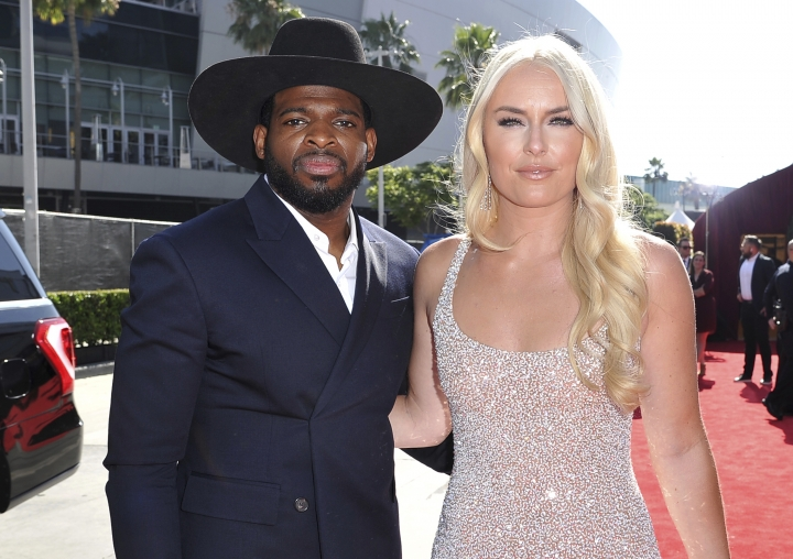 FILE - In this July 10, 2019 file photo, P. K. Subban of the New Jersey Devils, left, and Lindsey Vonn arrive at the ESPY Awards at the Microsoft Theater in Los Angeles. Vonn and P.K. Subban say they're engaged. Vonn, a three-time Olympic champion in Alpine skiing, and Subban, a defenseman for the NHL's New Jersey Devils who won a Winter Games hockey title with Canada, posted the good news on social media on Saturday, Aug 24. (Photo by Richard Shotwell/Invision/AP, File)