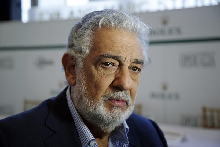FILE - In this Aug. 26, 2014, file photo, Placido Domingo speaks at the Dorothy Chandler Pavilion in Los Angeles. LA Opera has named former United States Attorney Debra Wong Yang on Tuesday, Aug. 20, 2019, to lead an 'independent investigation' into allegations of sexual harassment against Domingo. The investigation into Domingo's behavior follows an Associated Press report detailing multiple accusations against the opera star. (AP Photo/Damian Dovarganes, File)