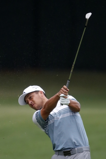 Xander Schauffele hits from the fairway on the 11th hole during third-round play in the Tour Championship golf tournament Sunday, Aug. 25, 2019, at East Lake Golf Club in Atlanta. (AP Photo/John Bazemore)