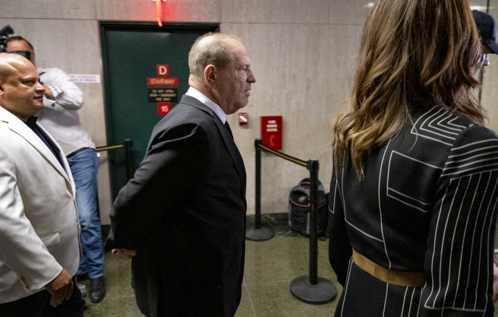 Harvey Weinstein, center, appears in a courthouse for a scheduled arraignment Monday, Aug. 26, 2019, in New York. Weinstein's lawyers want the trial moved from New York City to Long Island or upstate New York, part of the last-minute wrangling that includes efforts by prosecutors to bolster their case with testimony from actress Annabella Sciorra, who says Weinstein raped her in the 1990s. Weinstein has denied all accusations of non-consensual sex. (AP Photo/Craig Ruttle)