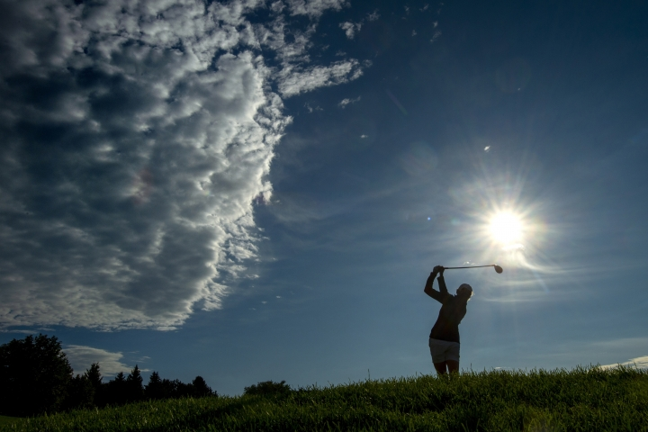 Stacy Lewis tees off on the third hole during the first round of the CP Women's Open in Aurora, Ontario, Thursday Aug. 22, 2019. (Frank Gunn/The Canadian Press via AP)