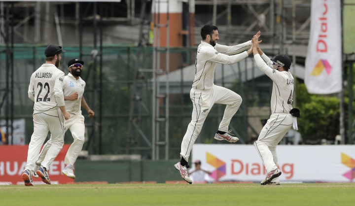 New Zealand's William Somerville, second right, celebrates taking the wicket of Sri Lanka's Kusal Mendis with his teammates during day five of the second test cricket match between Sri Lanka and New Zealand in Colombo, Sri Lanka, Monday, Aug. 26, 2019. (AP Photo/Eranga Jayawardena)