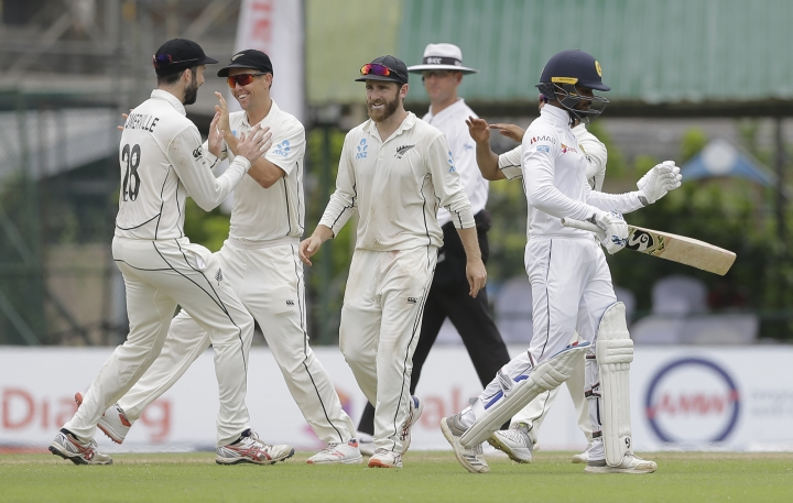 New Zealand team members celebrate the dismissal of Sri Lanka's Dhananjaya de Silva with his teammates during day five of the second test cricket match between Sri Lanka and New Zealand in Colombo, Sri Lanka, Monday, Aug. 26, 2019. (AP Photo/Eranga Jayawardena)