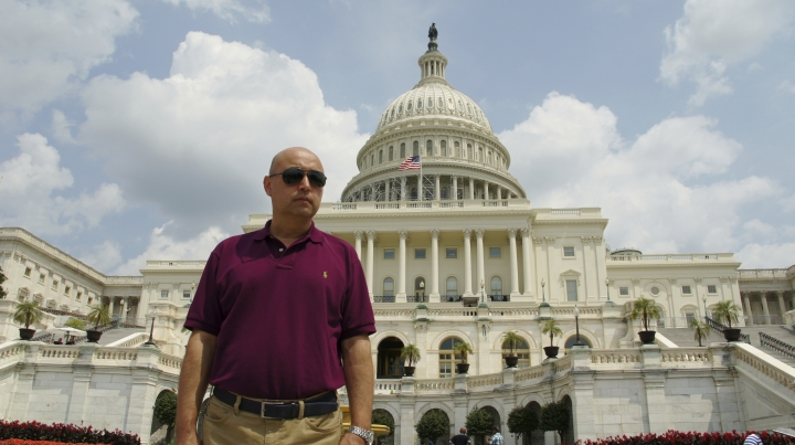 This Aug. 11, 2014, photo provided by his family shows Yalqun Rozi during a family trip to Washington. Rozi is one of over four hundred prominent Uighur academics, writers, performers and artists who have been detained, according to advocacy groups, joining an estimated one million people or more held in internment camps and prisons in China's far western region of Xinjiang. (AP Photo/Yalqun Family)