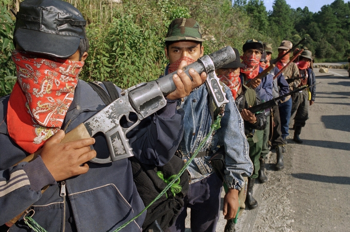 FILE - In this Jan. 3, 1994 file photo, members of the Zapatista Army of National Liberation (EZLN) stand guard at roadblock along the route from San Cristobal de las Casas to Ocosingo, Chieapas state, Mexico. (AP Photo/Damian Dovarganes, File)