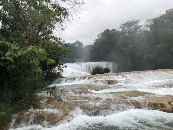 This Feb. 13 photo shows a series of cascades at Agua Azul in the southern Mexican state of Chiapas, Feb. 13, 2019. The site is named for a distinctive turquoise blue seen in some parts that is caused by the water's mineral content. The site is reached after an hours-long ride on the state's winding main highway, past small towns and jungle vegetation. (AP Photo/Anita Snow)