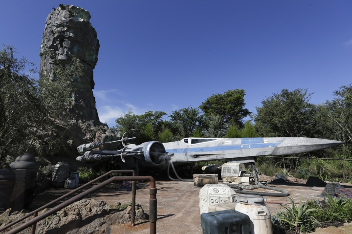 The X-Wing ship stands ready for flight at a display during a preview of the Star Wars themed land, Galaxy's Edge in Hollywood Studios at Disney World, Tuesday, Aug. 27, 2019, in Lake Buena Vista, Fla. The attraction will open Thursday to park guests. (AP Photo/John Raoux)