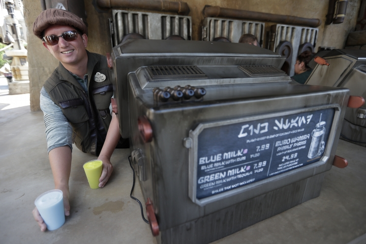 Blue Milk and Green Milk are among the refreshments for sale to guests during a preview of the Star Wars themed land, Galaxy's Edge in Hollywood Studios at Disney World, Tuesday, Aug. 27, 2019, in Lake Buena Vista, Fla. The attraction will open Thursday to park guests. (AP Photo/John Raoux)