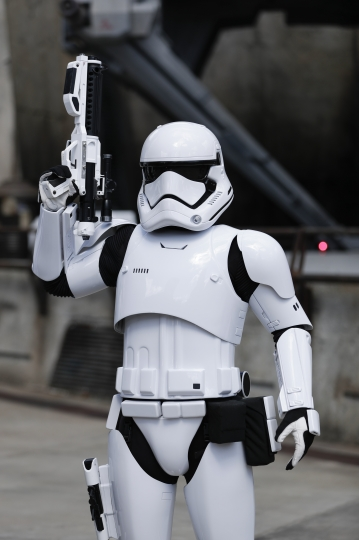 A storm trooper makes his way in the Star Wars themed land, Galaxy's Edge during a preview at Hollywood Studios at Disney World, Tuesday, Aug. 27, 2019, in Lake Buena Vista, Fla. The attraction will open Thursday to park guests. (AP Photo/John Raoux)